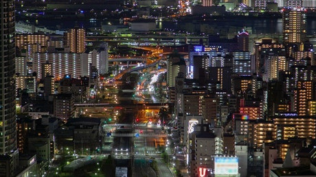 Huge city with avenues and illuminated buildings