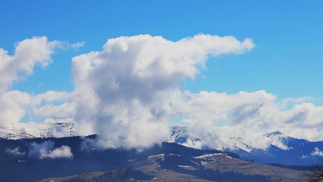 Huge clouds moving over the mountains