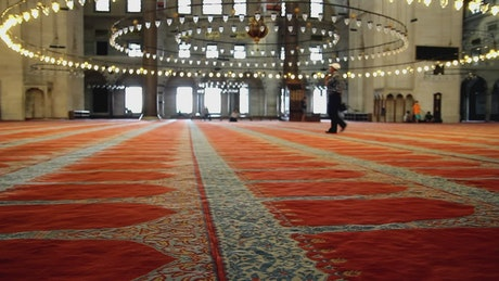 Huge living room with a carpet inside a mosque