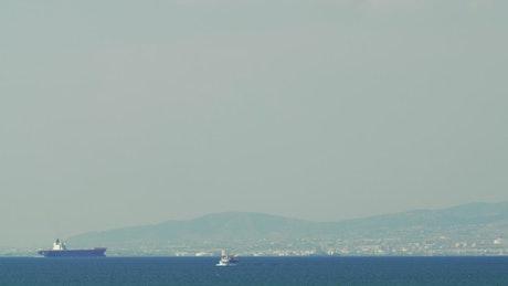 Huge ship arriving at a coastal city
