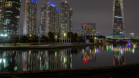 Huge skyscrapers illuminated in colors at night