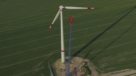 Huge wind turbine under repair seen from the air