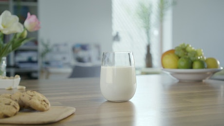 I am taking a glass of milk from the table