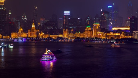 Illuminated buildings by the Shanghai river