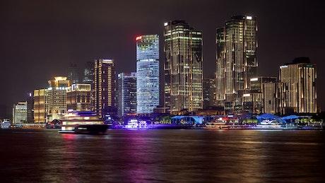 Illuminated chinese boats in Shanghai harbor