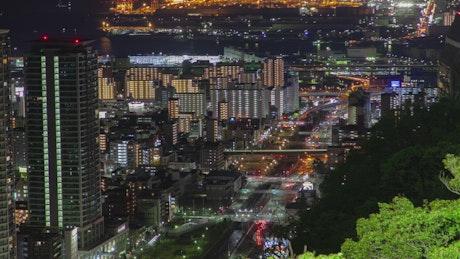 Illuminated city with fast traffic at night