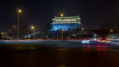 Iluminated Chinese historic building and traffic