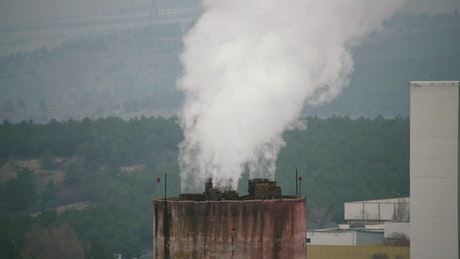 Industrial chimney unloading pollution to the air