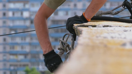 Industrial climber adjusting equipment to work