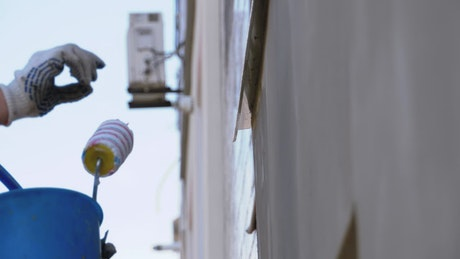 Industrial climber applying concrete to a wall
