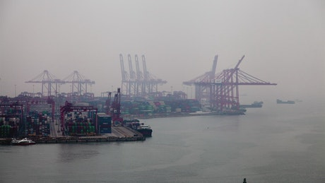 Industrial container port on a foggy morning