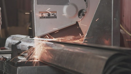 Industrial saw cutting through metal