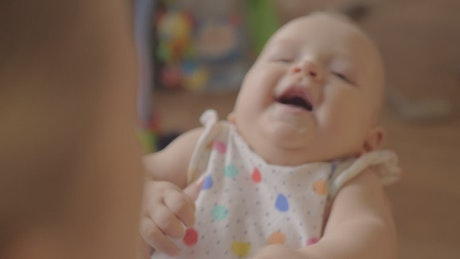 Infant laughing with her Mother