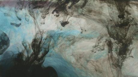 Ink dripping through water