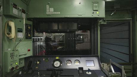 Inside a rear control cabin of a subway train