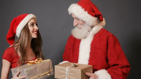 Instagram photoshoot: Santa Claus and his female helper