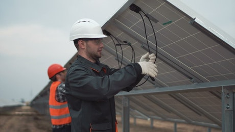Installing solar panels on a cloudy day