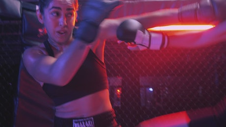 Intense mixed martial arts combat between two women
