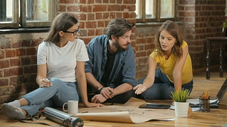 Interior designer helping women idealize plan