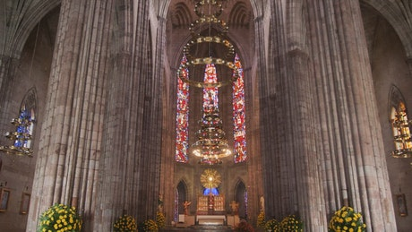Interior of a huge gothic church with large columns