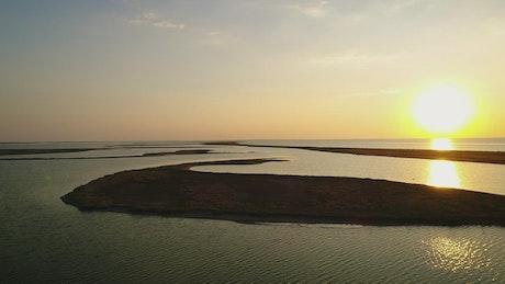 Irregular landforms in the sea during sunset