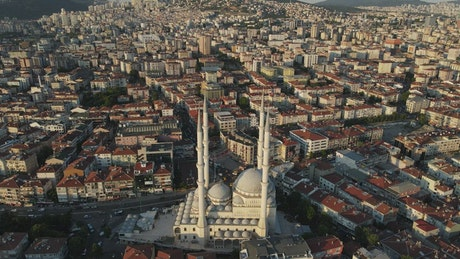 Islam mosque in a city, aerial view