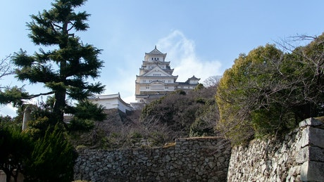 Japanese white building high up seen from below