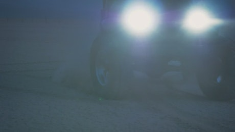 Jeep truck skidding on the ground at night