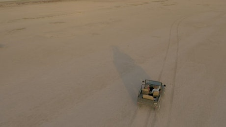 Jeep zigzagging through an immense desert