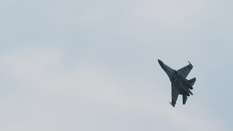 Jet military aircraft crosses the sky