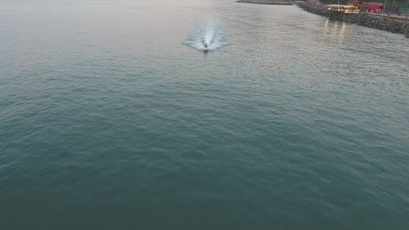 Jet ski crossing the lake at high speed