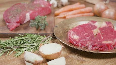 Keto diet raw steak display on rustic table