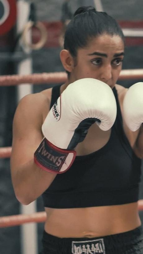 Kickboxer punching her coach
