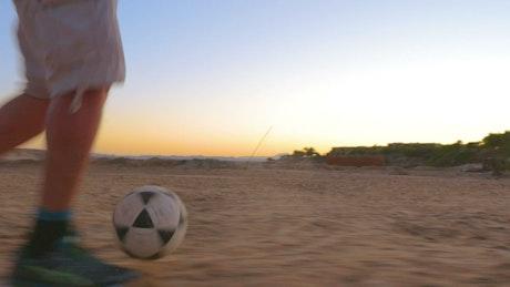 Kicking a ball into a goal
