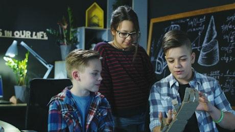 Kids exploring robotic cardboard mechanism