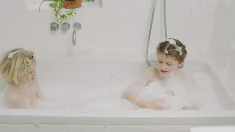 Kids making a mess in the bath