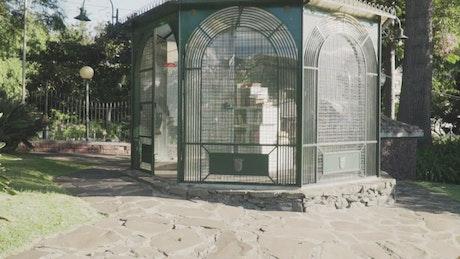 Kiosk with books inside in a garden