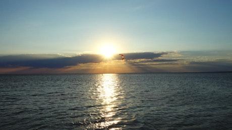 Kite boarding at sunset