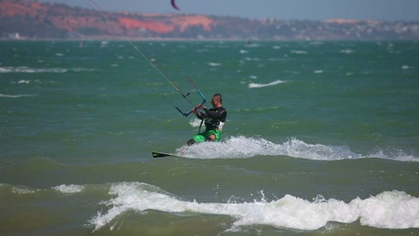 Kite surfer riding the waves