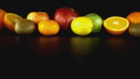 Kiwi halved close to more fruit