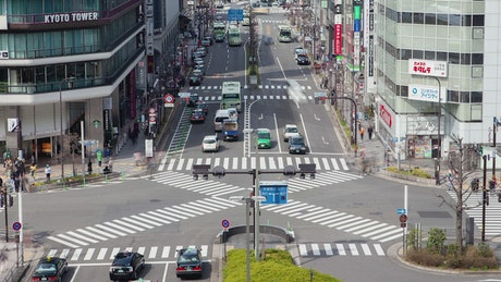 Kyoto busy street with crosswalks time lapse
