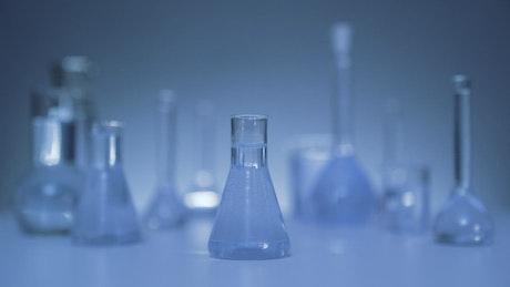 Laboratory flasks with blue liquid