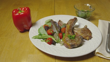 Lamb with salad and herbs