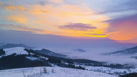 Landscape from the top of a snowy mountain range
