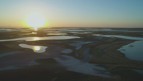 Landscape of an area with lagoons at sunrise