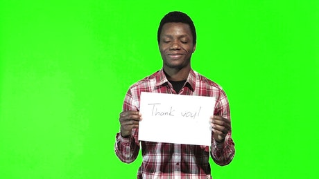Language thank you sign and a green screen