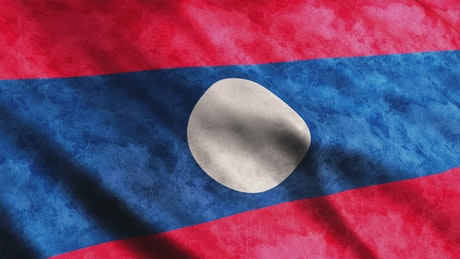 Laos flag with faded texture while waving