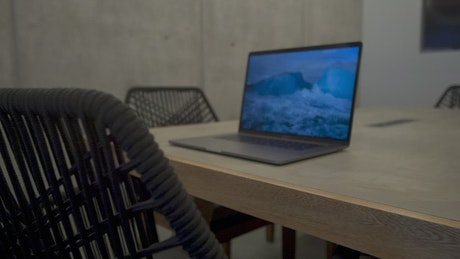 Laptop on wooden table