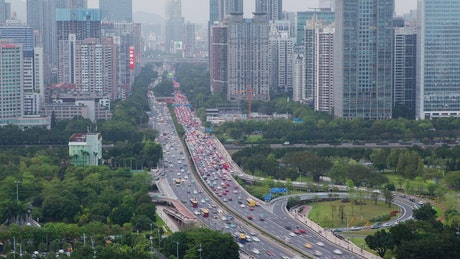 Large avenue full of cars in a huge city