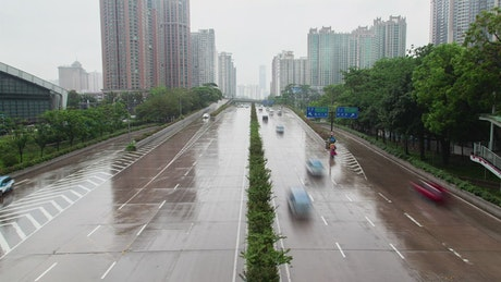 Large avenue in a big city during a rainy day